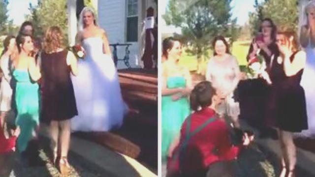 Bride is about to toss the bouquet, but when she suddenly