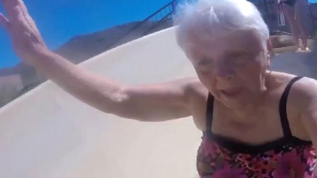 80-Year-Old Agrees To Go Down Waterslide Resulting In Comical Footage Thats Warming Hearts