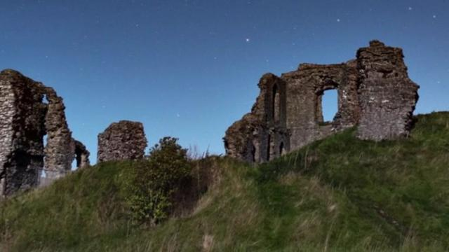 Once in a lifetime moment a meteor explodes above an English castle