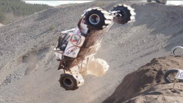 buggy climbs up cliff - 1003751