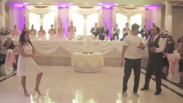 The father of the bride interrupts the first dance, and the guests love it