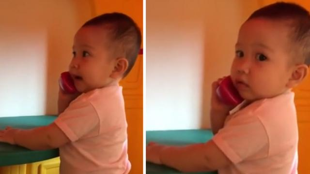 Baby talking on the phone will brighten your day!