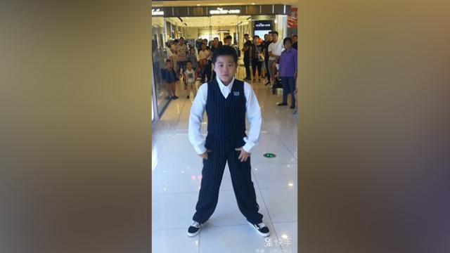 Boy goes viral for incredible hip-hop and head isolation moves that leave the crowd in awe