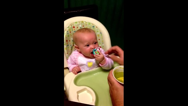 My six month old baby says first words 'I done' after trying peas for the first time (1)