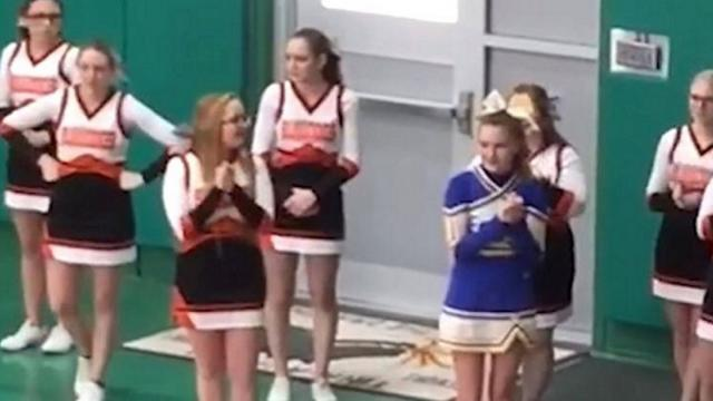 Cheerleaders surround girl from rival team. Actions caught on film leave internet in disbelief