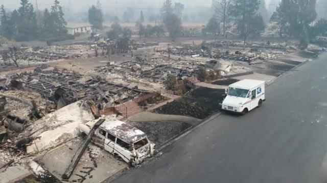 Wildfires couldn't drag this mail carrier away