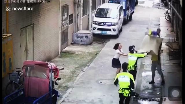 Police and delivery man catch baby falling from first-floor balcony