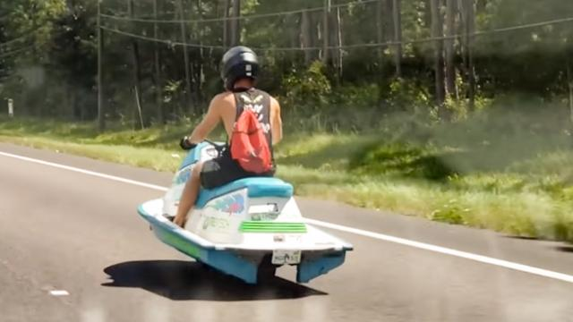 Driver Reacts With Astonishment to Jet Ski Moving on Land