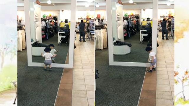 Adorable baby mistaken himself as a different kid in the mirror
