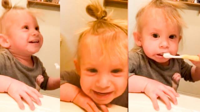 Cheeky girl pretends she's using electric toothbrush