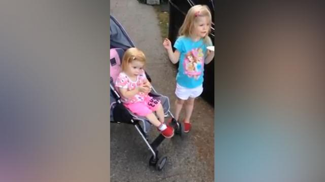 2 Girls Are Watching Marching Band Only To Have Little One In Pink Steal The Spotlight