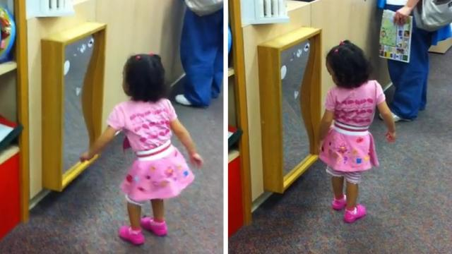 Toddler Checks Herself In Store Mirror_Large