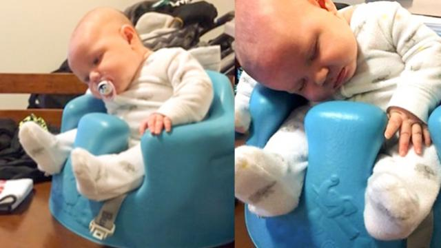 Adorable moment baby battles to keep her eyes open whilst waiting for army dad to return