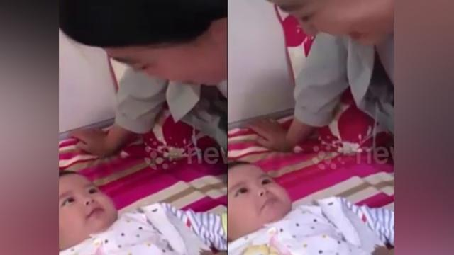 Five-month-old baby imitates mum's expressions