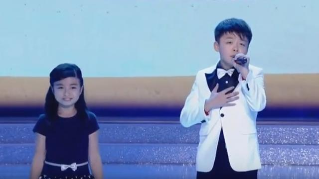 Two Kids With Soaring Voice Sing You Raise Me Up at the Beauty Contest So Touchingly That the Audi