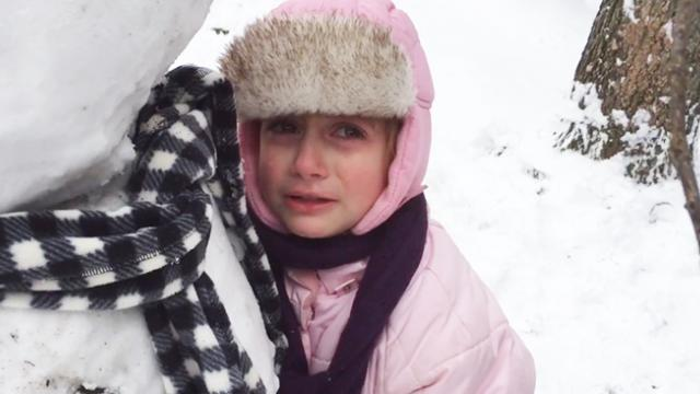 Little Girl Sobs And Refuses To Leave Snowman's Side