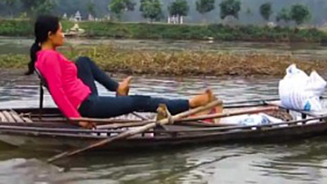 The Vietnamese rows with the feet that makes the tourists get curious