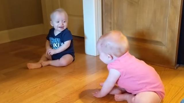 Twin Babies Laugh Uncontrollably Looking at Each Other