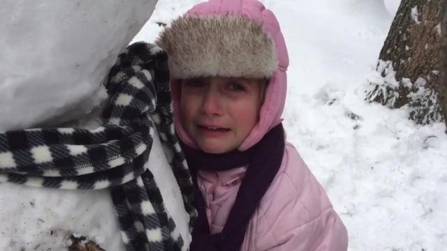 Little Girl Sobs And Refuses To Leave Snowmans Side