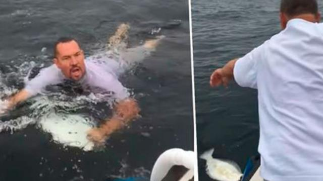 Guy Leaps Into Ocean To Catch Unhooked Fish With His Hands