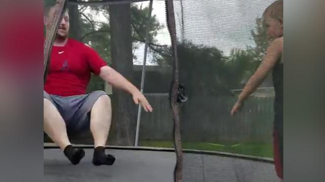 Funny Dad Tries To Show Off On Trampoline