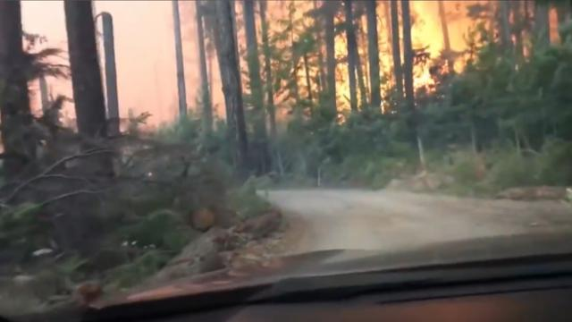 Hikers Barely Escape As Wildfire Surrounds Them in Glacier National Park; Video