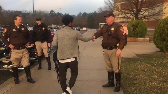 County Deputies Greet Returning Students With Handshakes,