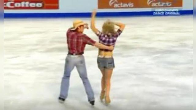 Cowboy grabs ahold of woman on ice. Their daring next move has everyone on their feet