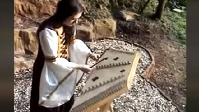 Renaissance Performer's Intricate Song On Hammered Dulcimer Is
