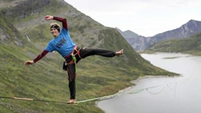 Incredible pictures show man walking world's longest slackline
