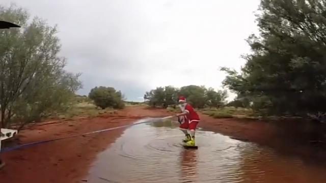Wakeboarding Santas Ride Uluru Floodwaters on Christmas Day