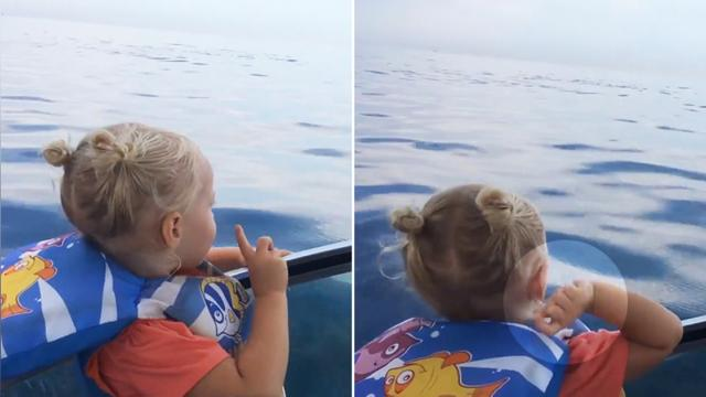 Young girl is on a boat with her family But when she waves