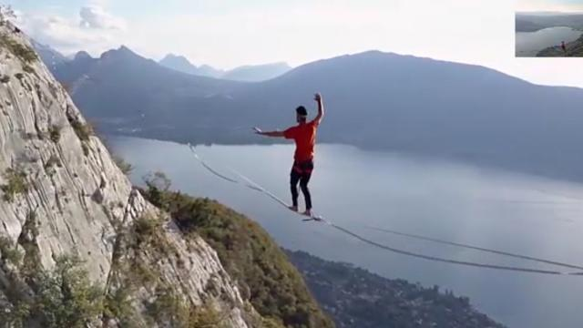 Daring slackliner crosses above French alps completely blindfolded