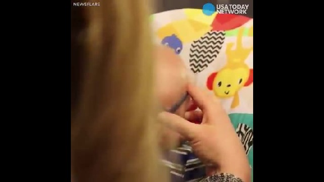 USA TODAY - Share in the joy as this baby gets glasses and sees mom