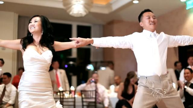 Bride responds to grooms quizzical look by dropping the hottest move on the floor