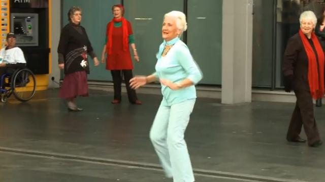 Elderly Woman Is Just Walking By, But When The Music Starts, Its Showtime