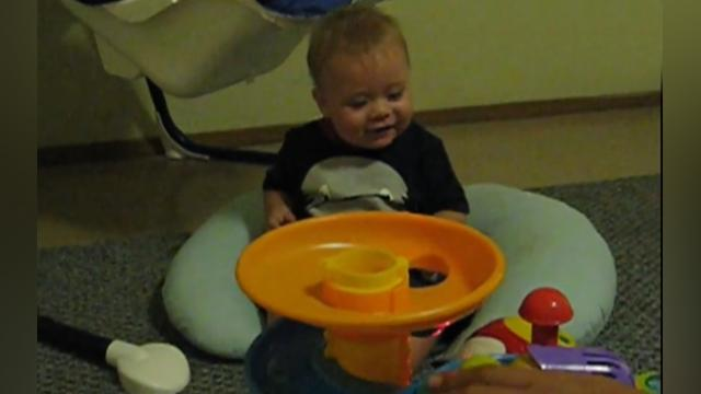 Baby boy freaks out over ball machine