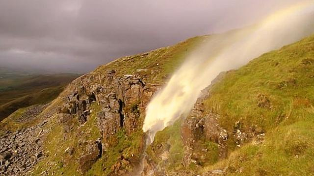 Stunning moment winds from Storm Helene cause a waterfall to REVERSE