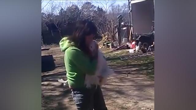 Happiest goose ever gives woman a hug