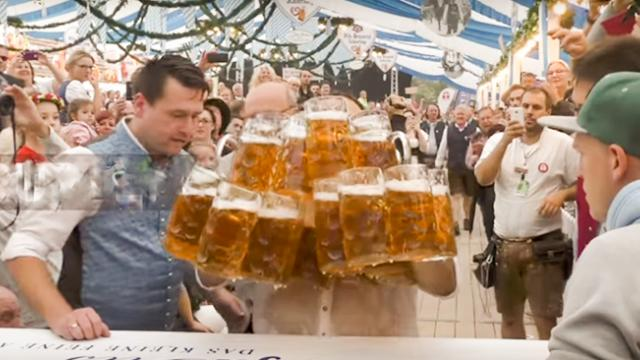 I only ordered one! Bavarian breaks beer carrying world record carrying 29 steins