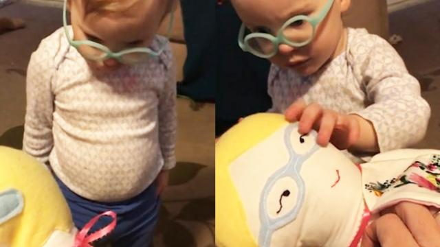 Adorable moment deaf baby receives mini-me doll and instantly notices the cochlear implants on her h