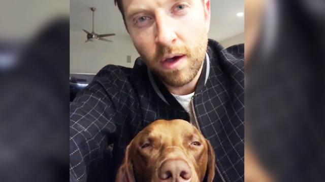 01 Video of country star singing a lullaby to his dog has gone viral