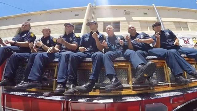 La firefighters are dared to dance. When music begins, their moves have everyone grooving along