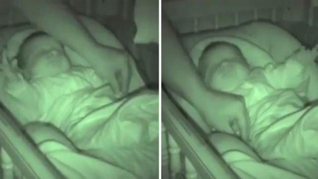 Sleeping baby shows hilarious reflex when his parents play with