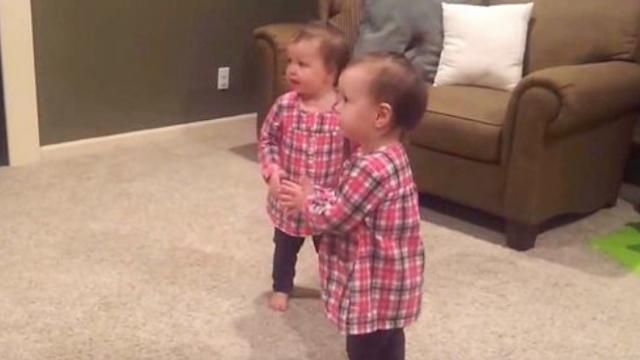 Identical Twins Hear Daddy's Guitar Begin Synchronized Dance That Has Mommy In Laughte