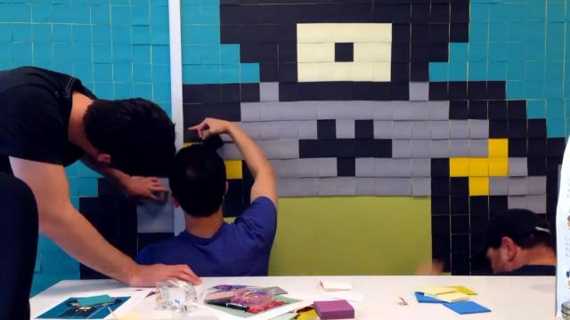 Office Worker Uses 8,024 Post-It Notes To Transform Boring Office Walls Into Superhero Murals