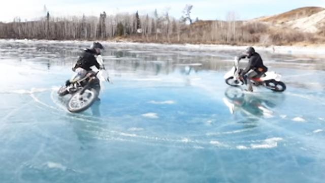 Brave Biker Performs Donuts on Frozen Lake - Storyful Video