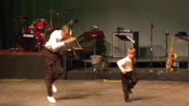 Little boy slaps a high five, steals the show when he joins famous dancer on stage