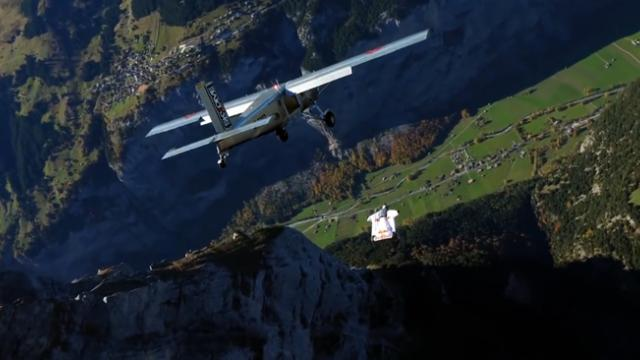 Wingsuit flyers perform mid-air landing through an airplane door
