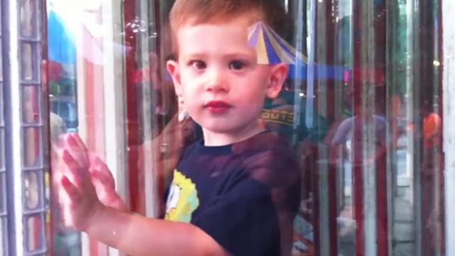 Little Boy Helplessly Fumbles Around Inside Maze Of Fun House Mirrors